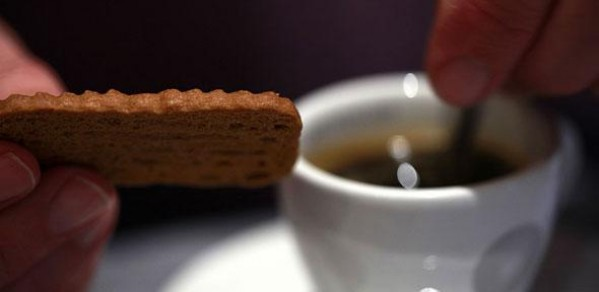 Dunking a cookie into a cup of coffee
