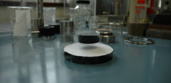 A bulk superconductor levitated by a permanent magnet