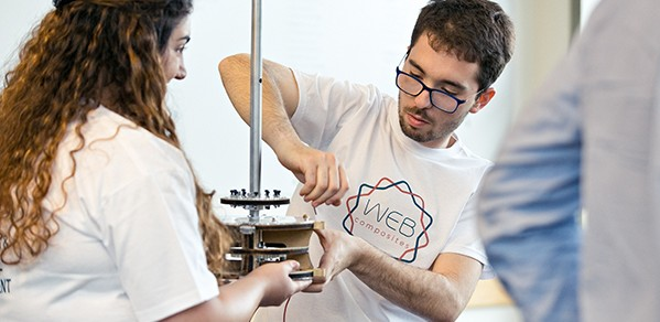 MET students Elena Odysseos and Ioannis Menicou demonstrate the WEB Composites team's weaving machine.