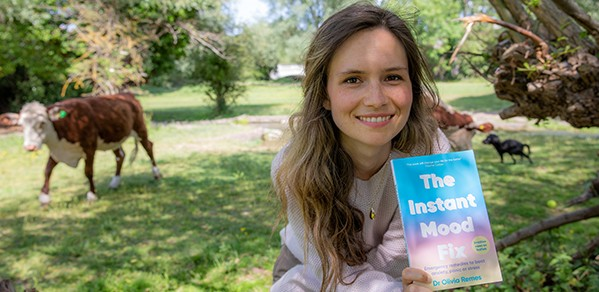 Dr Olivia Remes with a copy of her new book, The Instant Mood Fix, which is based on science.