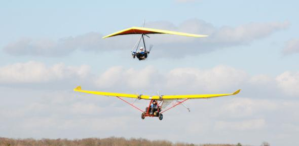 The E-Lazair electric aircraft and the E-Dragonfly hang-glider, low level flypast in formation at Sywell Aerodrome