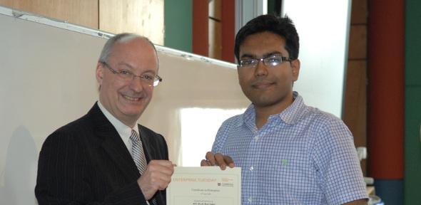 Mash-Hud Iqbal receiving the Certificate in Enterprise with distinction from Professor Arnoud De Meyer