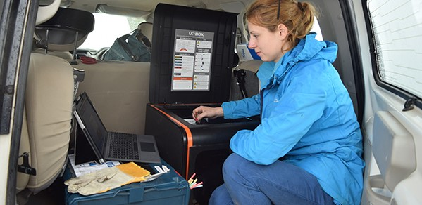 Abi prints a fetoscope in the back of a vehicle for a health post in an internally displaced persons (IDP) camp in Nepal.