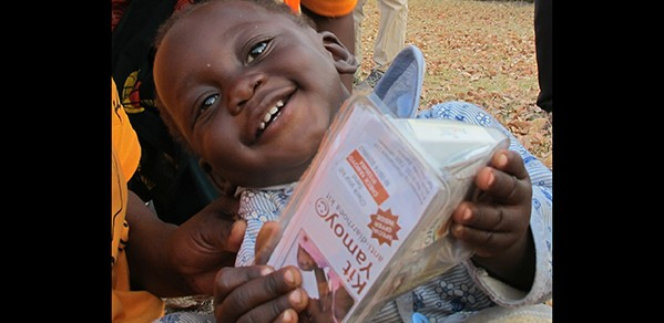 Baby with an anti-diarrhoea kit in Katete, Eastern Province, Zambia.
