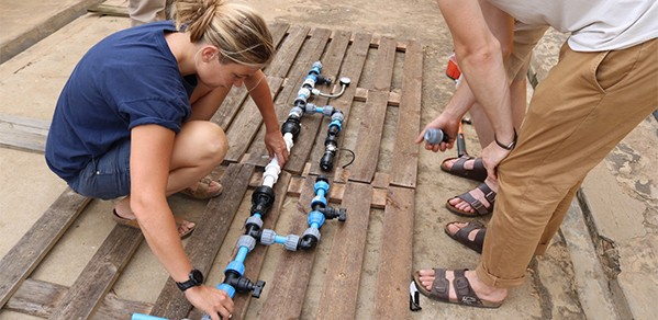 Blue Tap CEO Francesca O'Hanlon sets up a chlorine test rig in Uganda in 2018.