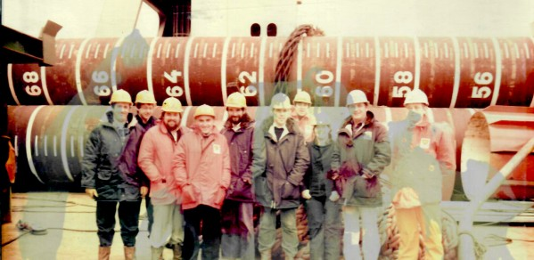 Alumna Helen Morton (third from right) BP civil engineer and colleagues working alongside the Magnus oil platform 1985