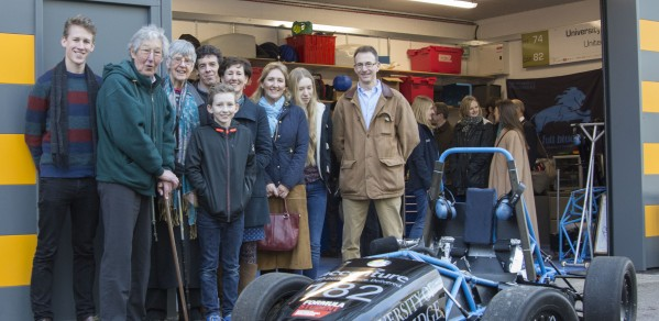 The Oatley family in front of the garage