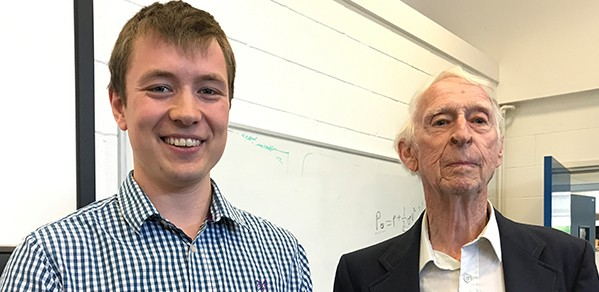 PhD student Lachlan Jardine accepts the Department's Helios Prize from donor John Firth.