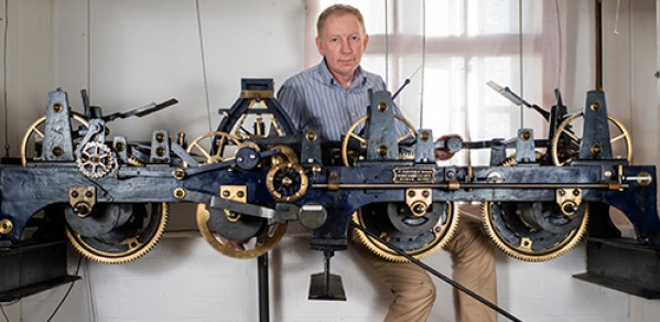 Dr Hugh Hunt with the Trinity College Clock.