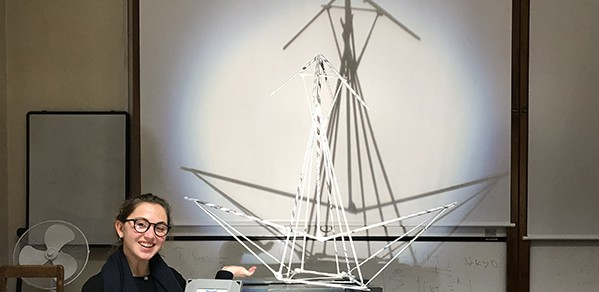 Undergraduate Aleyna Yildirim with her group's structure, 'Bird with folding wings'.