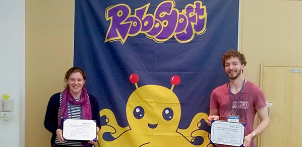 Engineering PhD students Josie Hughes and Kieran Gilday with their certificates.