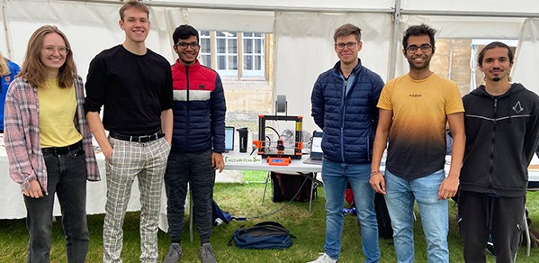 CCES President Aditya Jain (second right) and Vice President Ben Zandonati (second left) pictured with fellow undergraduate engineers at the Christ's Freshers' Fair.