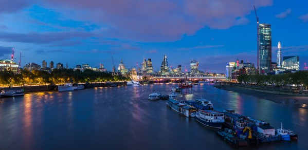 The skyline of London viewed along the Thames from Waterloo Bridge in London, England.