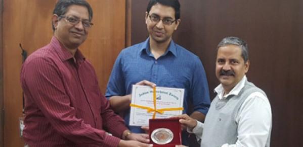 Srikanth Madabhushi (middle) and Gopal Madabhushi (left)