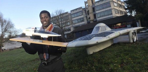 Keno with CUER solar car 'Endeavour' and a model of 'Evolution'