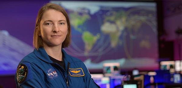 NASA astronaut Kayla Barron in the Blue Flight Control Room at NASA's Johnson Space Center in Houston.