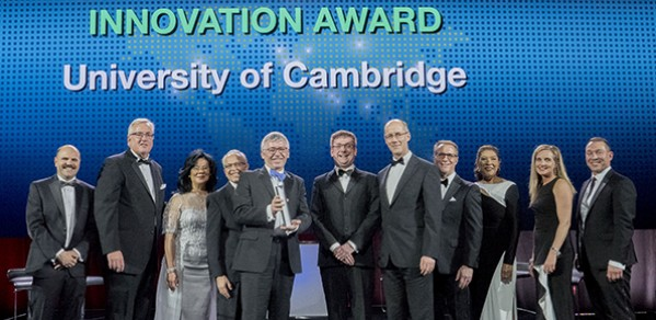 Collecting the Boeing Innovation Award on behalf of the University of Cambridge: Professor Bill O'Neill (holding the Award), Dr John Durrell (centre), and Philip Guildford (centre, right).