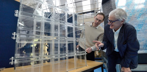 Professor Gary Hunt (left) with Sir James Dyson discussing the model of the James Dyson Building