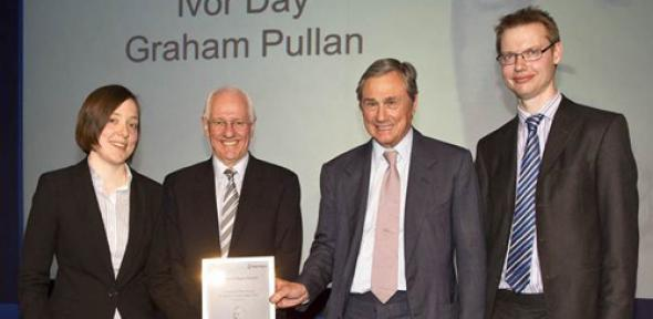 The prizewinners receiving their award from Sir Simon Robertson, Chairman, Rolls-Royce. From left: Dr Anna Young, Dr Ivor Day, Sir Simon Robertson and Dr Graham Pullan