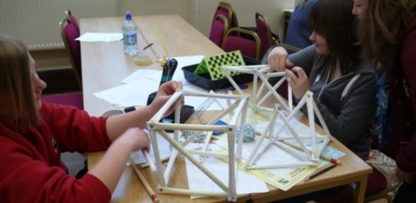 Cromwell Community College students build a truss bridge