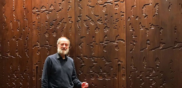 Professor Jim Woodhouse in front of the doors of the Ark which carry his spectrogram design.