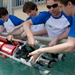 The team lowers Red Herring into the salt-water ballasting tank provided by the Nato underwater research center in Italy