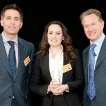 Maria Canellas (centre), collecting the award from Michael Portillo (right) and Nicholas Featherstone, Project Director at Laing