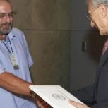 Dr Wilkinson (left) receiving his award