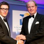Ben Sheppard receiving his prize from John Carlton
