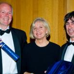 Professor Randall Thomas (left) and Allan McRobie (right) receiving the Happold Brilliant Award from Lady Happold