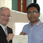 Mash-Hud Iqbal receiving the Certificate in Enterprise with distinction from Professor Arnoud De Meyer