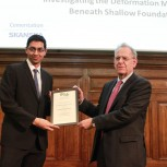 Srikanth Madabhushi (right) receiving his award from Prof Stephan Jefferis