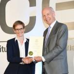 Professor Janet Lees receives her fellowship certificate from ICE President Professor Lord Robert Mair