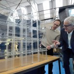 Professor Gary Hunt (left) with Sir James Dyson discussing a model of the James Dyson Building