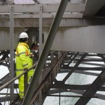 Yu Jia installing the energy harvester at the Forth Road Bridge